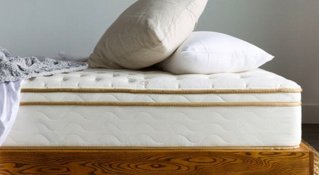 Saatva Classic Mattress with comfortable pillows on it