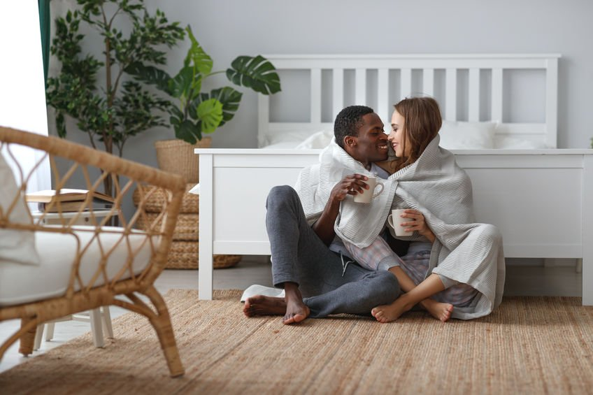 Couple in front of a a good bed frame for sex