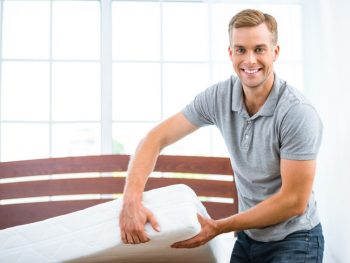 Man showing a type of bed mattress