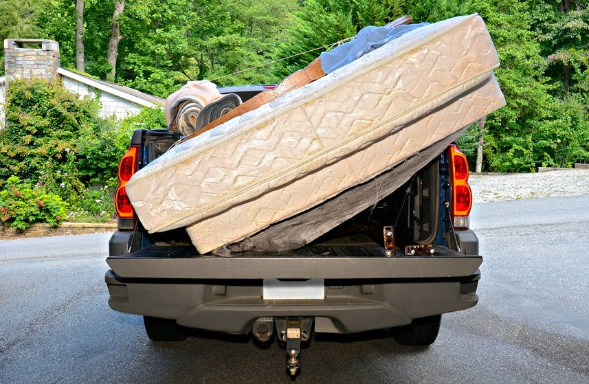 A truck carrying old mattresses for disposal